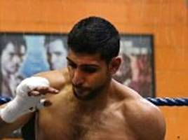 Amir Khan boosts chances of Floyd Mayweather fight by signing up with superstar's advisor