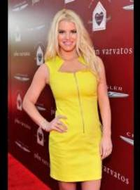 Jessica Simpson shows off sexy body in little yellow dress